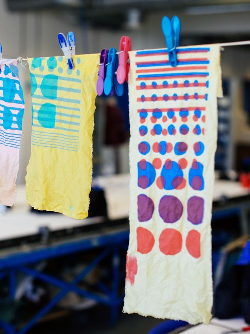 Colourful prints on fabric hanging on a line