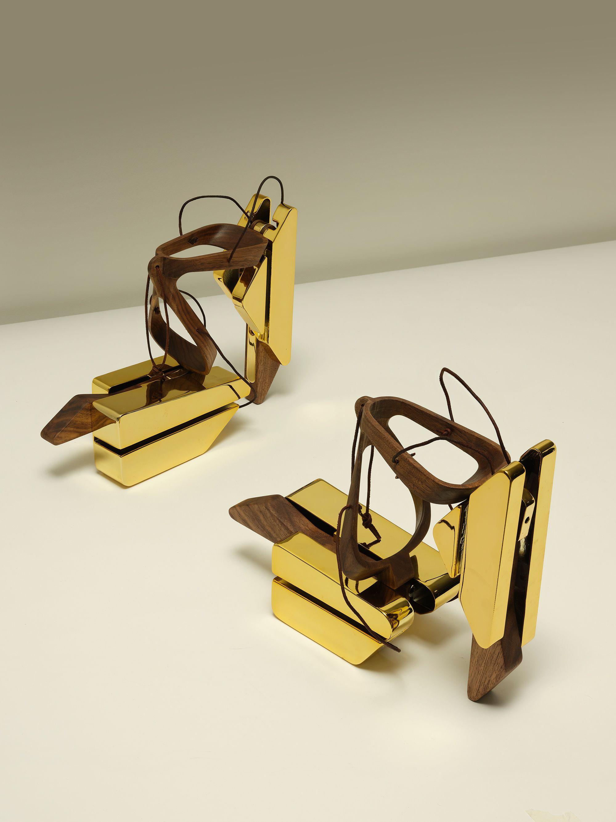 Golden high heeled shoes