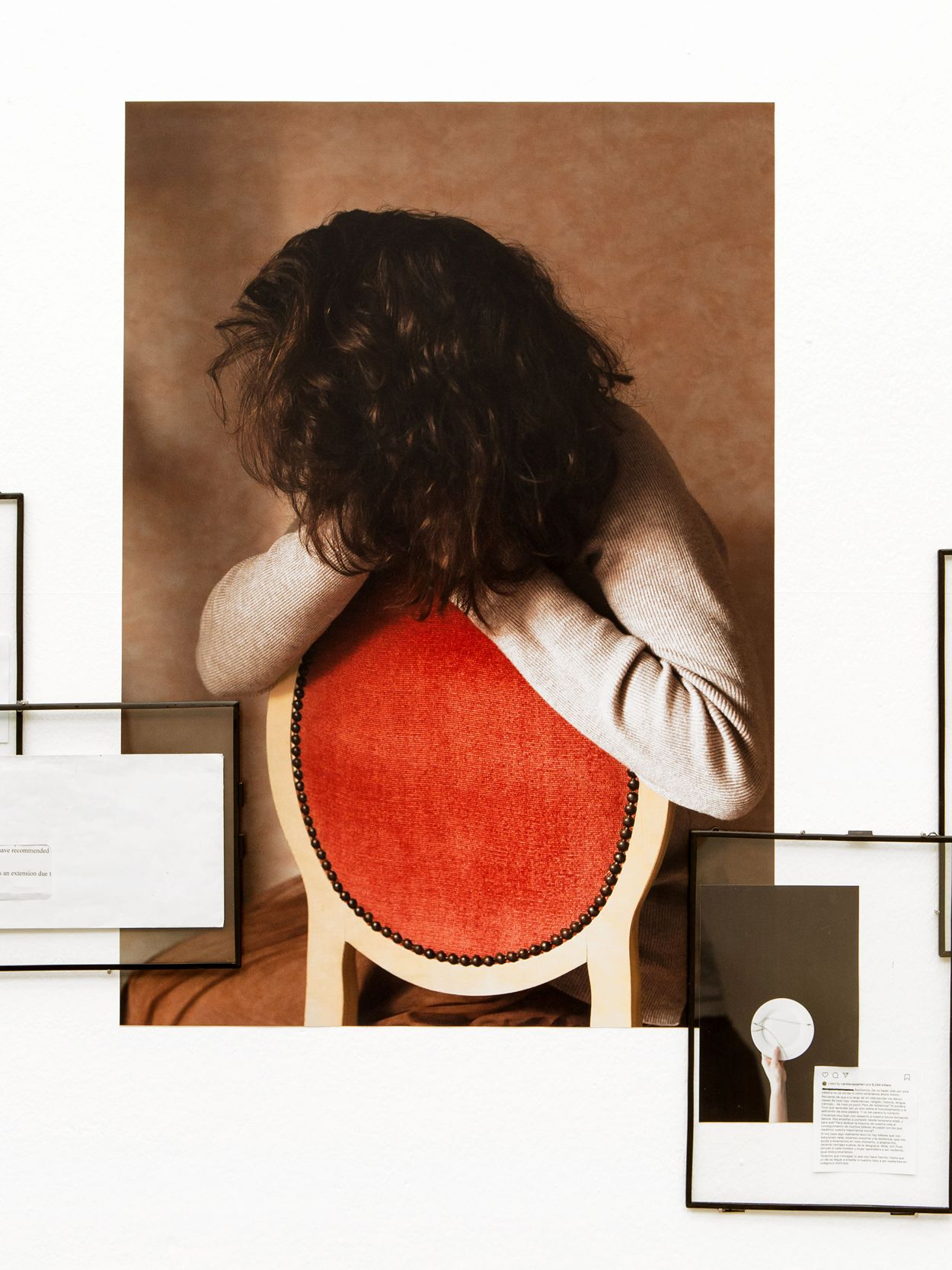 Mixed media photograph of a woman sitting on a red chair