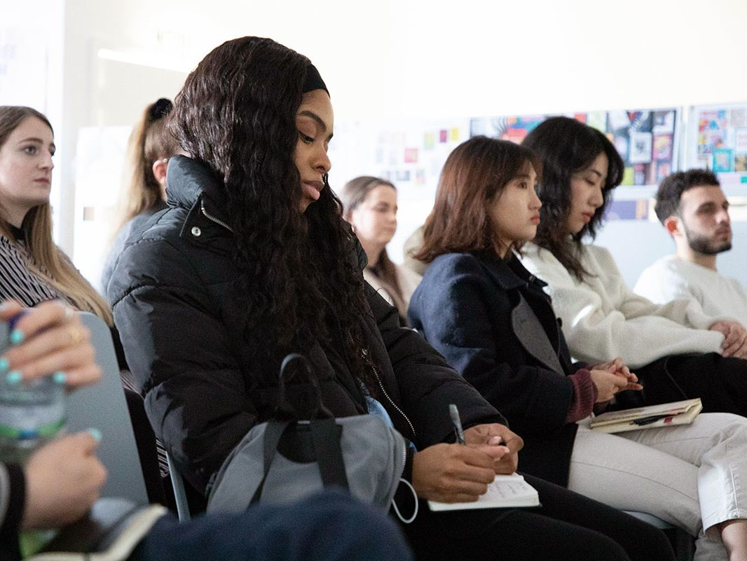 An audience of students attend one of the GBI industry events.