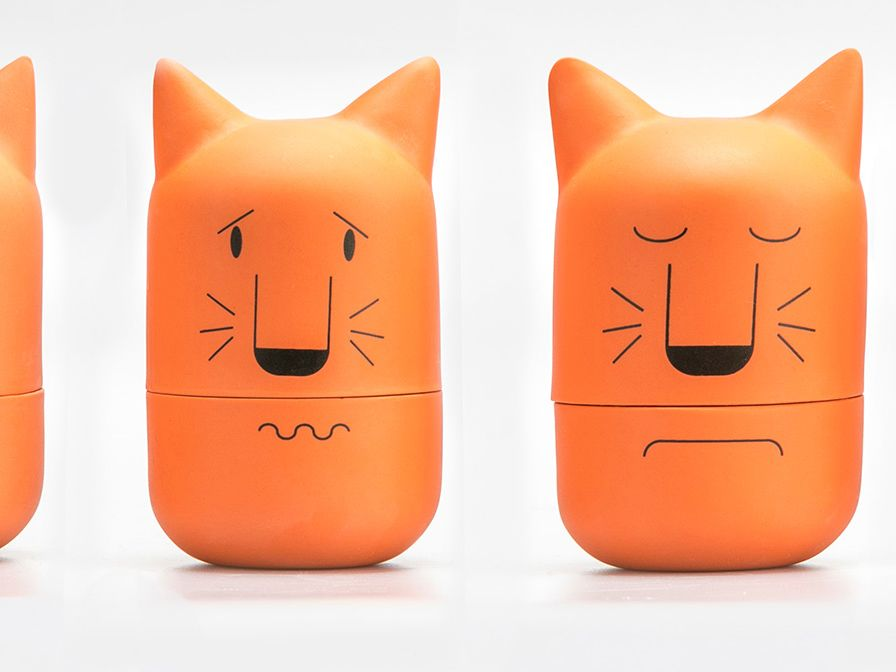 Four orange ceramic cat heads