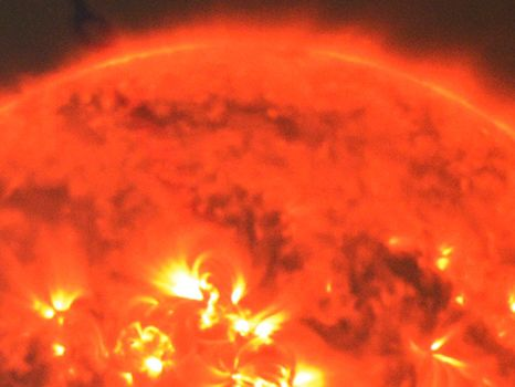A close-up computer generated image of the sun featuring solar flares erupting from it's surface.