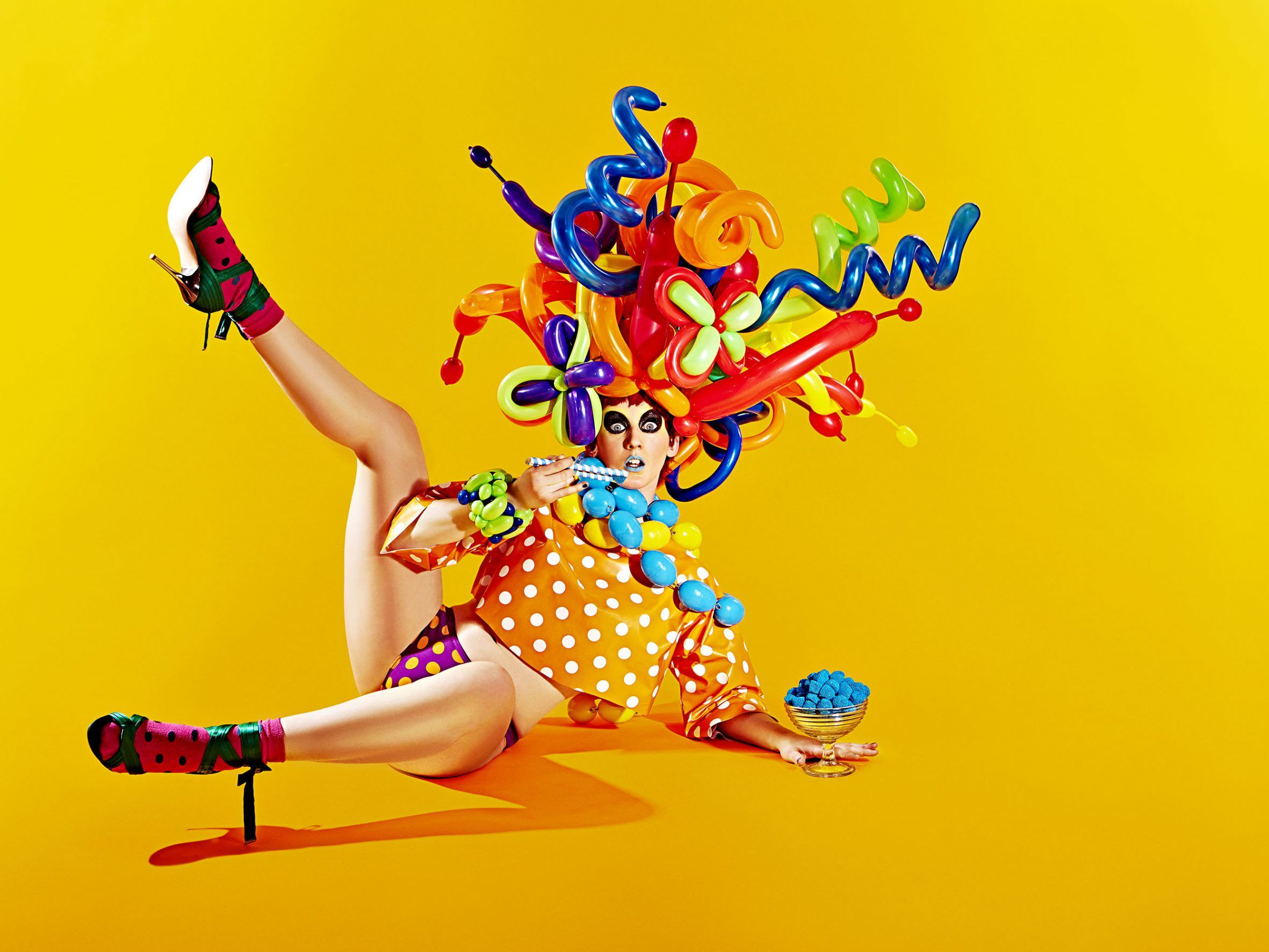 A fashion editorial featuring a woman wearing a variety of colours and shapes.