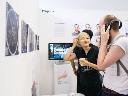 people having a conversation at an exhibition