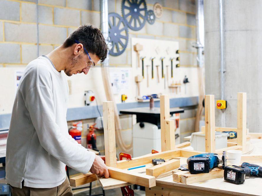 Boy assembling a wooden model