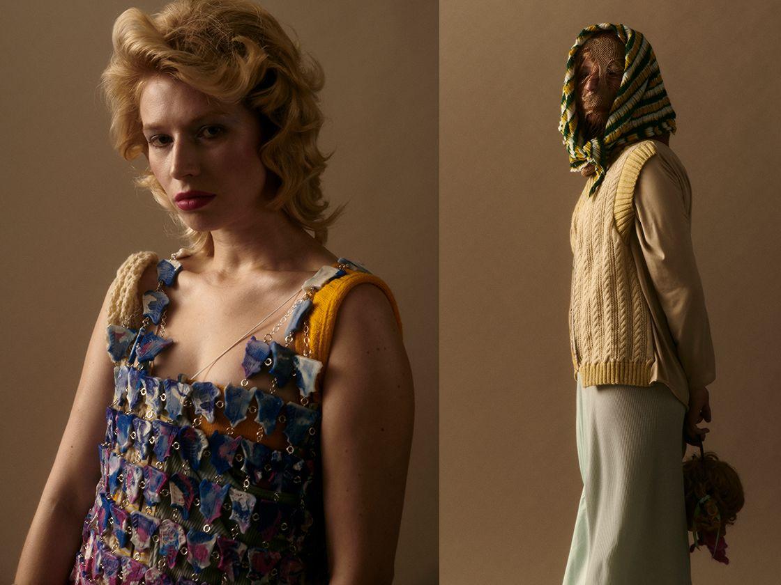 Model wearing positive blue knitwear covering face