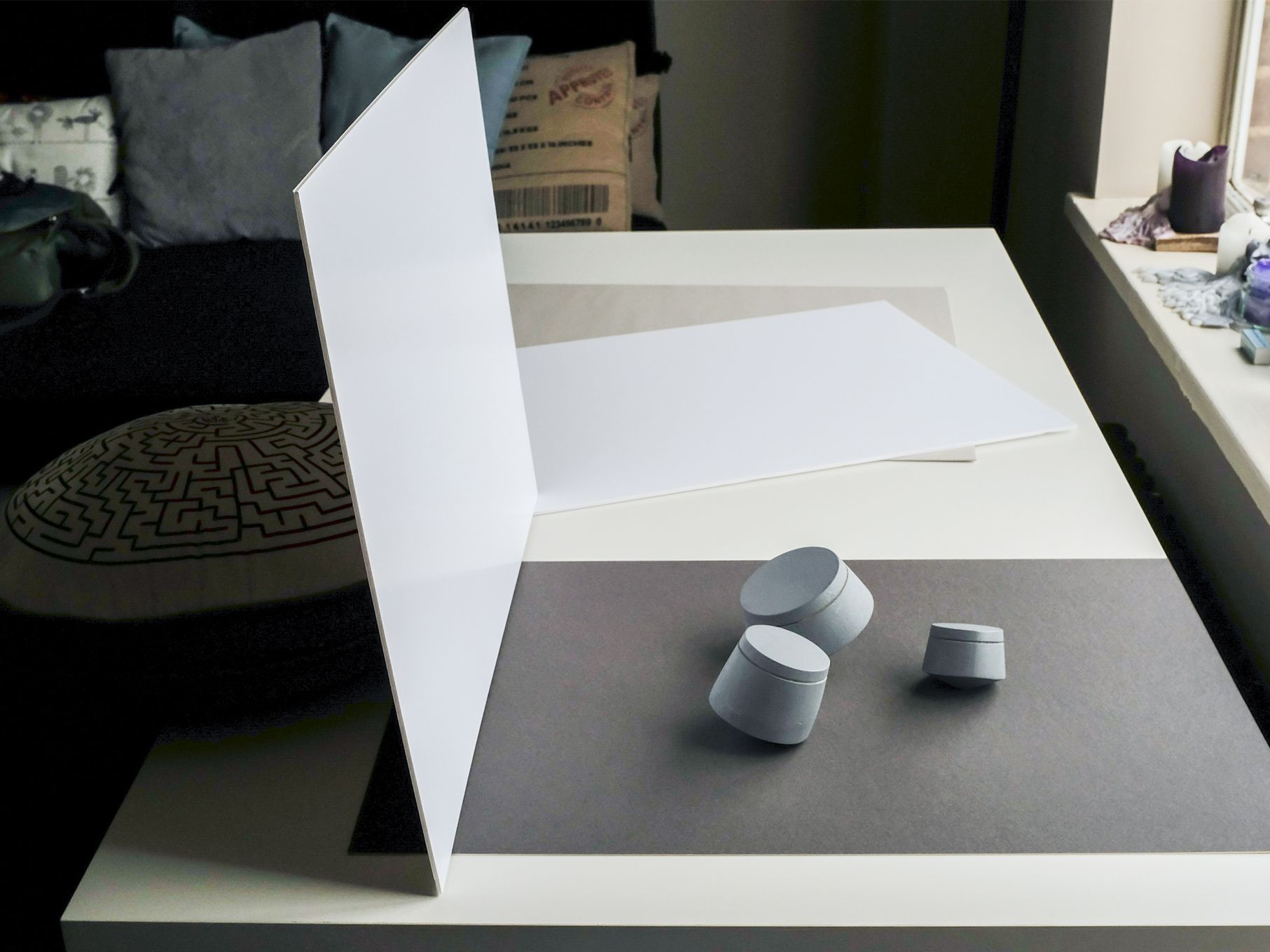a miniature photography studio with 3 small blue objects prepared for photographing