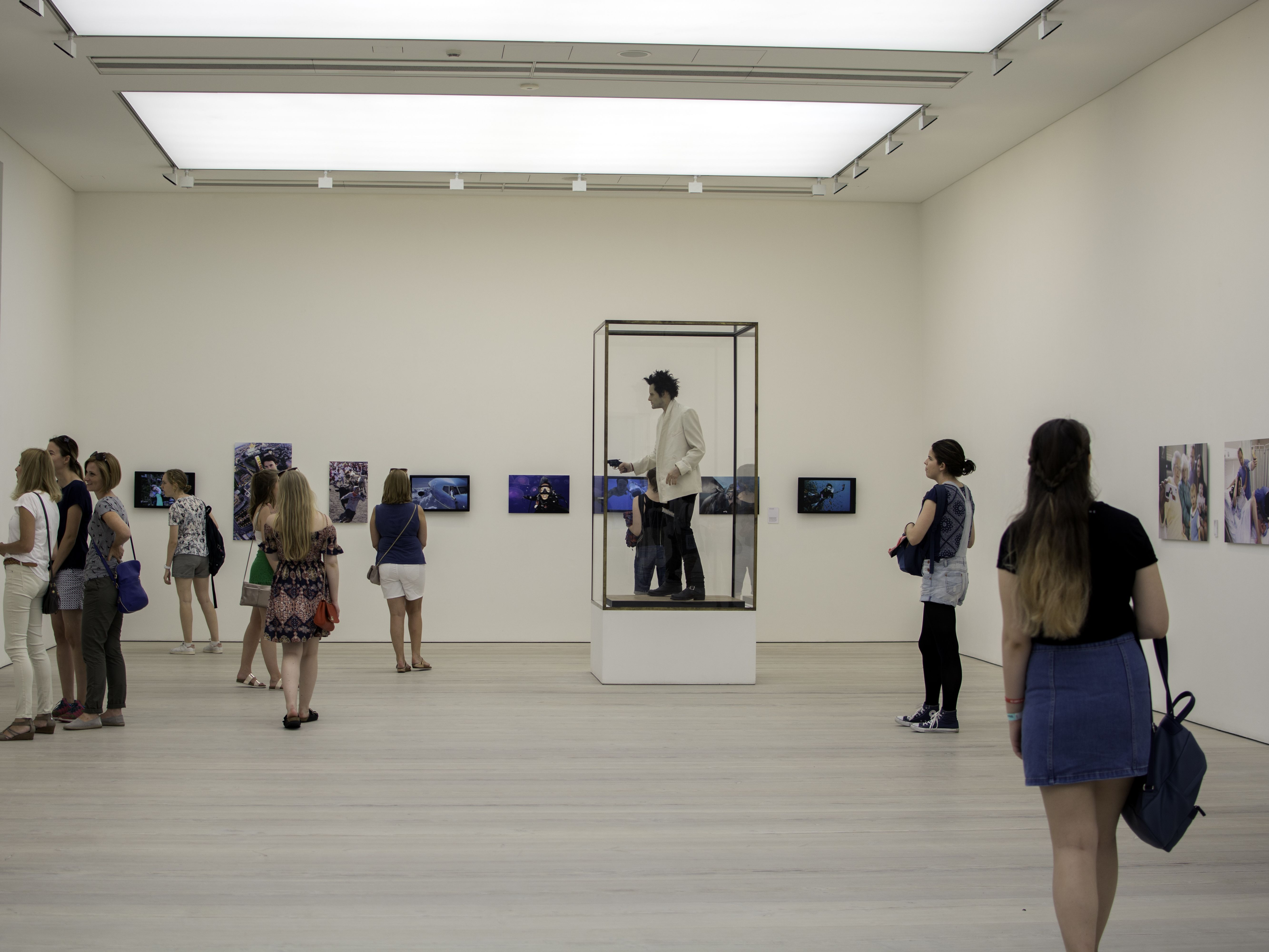 Group of students looking at art in a gallery
