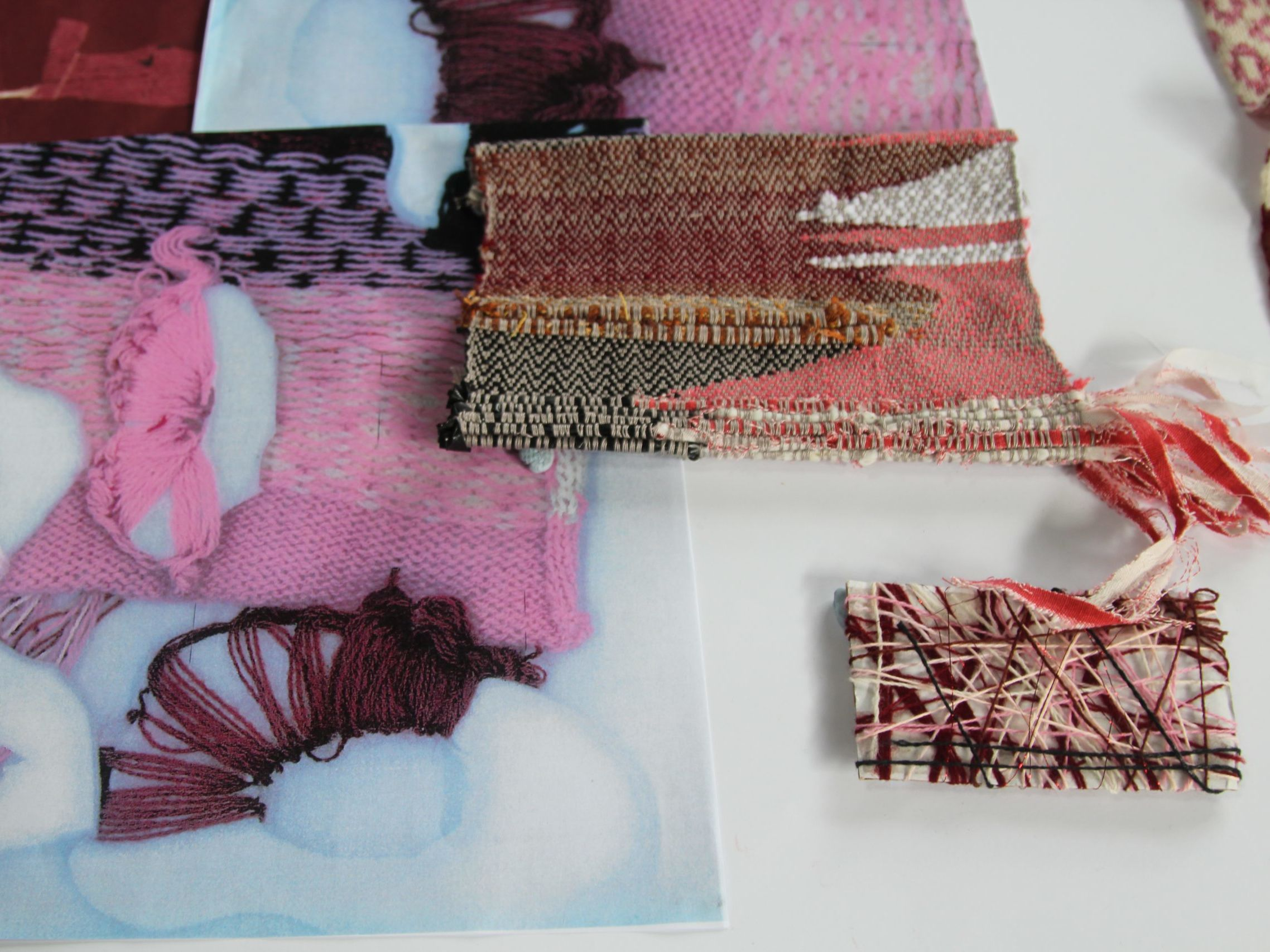 Birds eye view of textile samples in pink and maroon tones