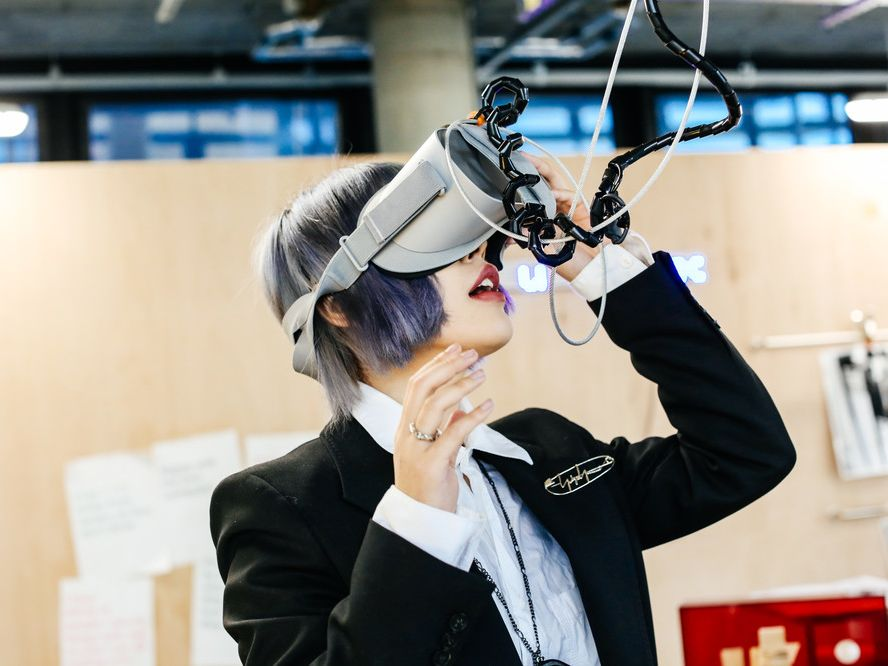 A girl engaging with a virtual reality set