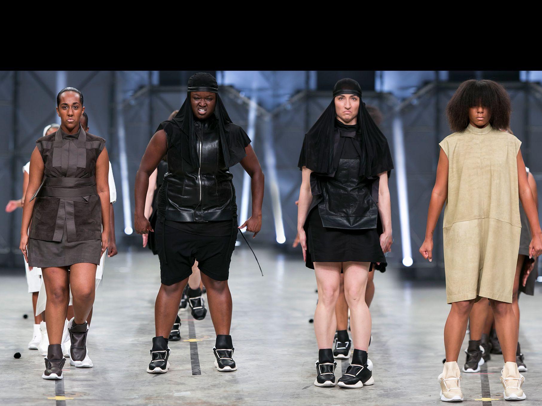Screen shot from fashion show featuring 4 women commanding the catwalk