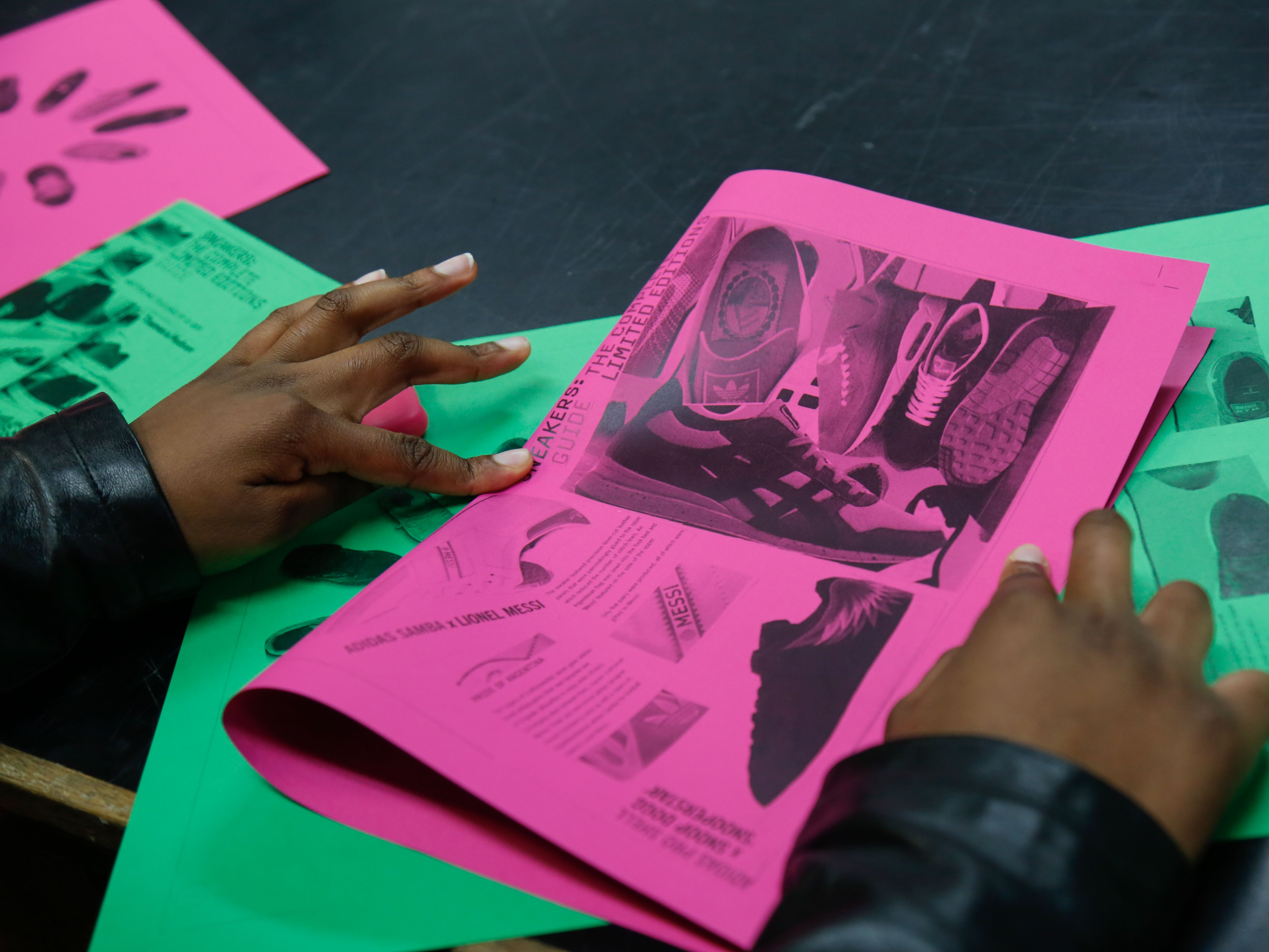 pink and green neon coloured zines with black printed graphics
