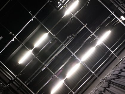 Photograph of large bright lights on the ceiling backstage of the Black Lab at Central Saint Martins