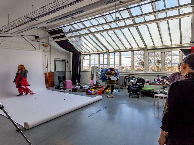 Students in a photography studio taking pictures
