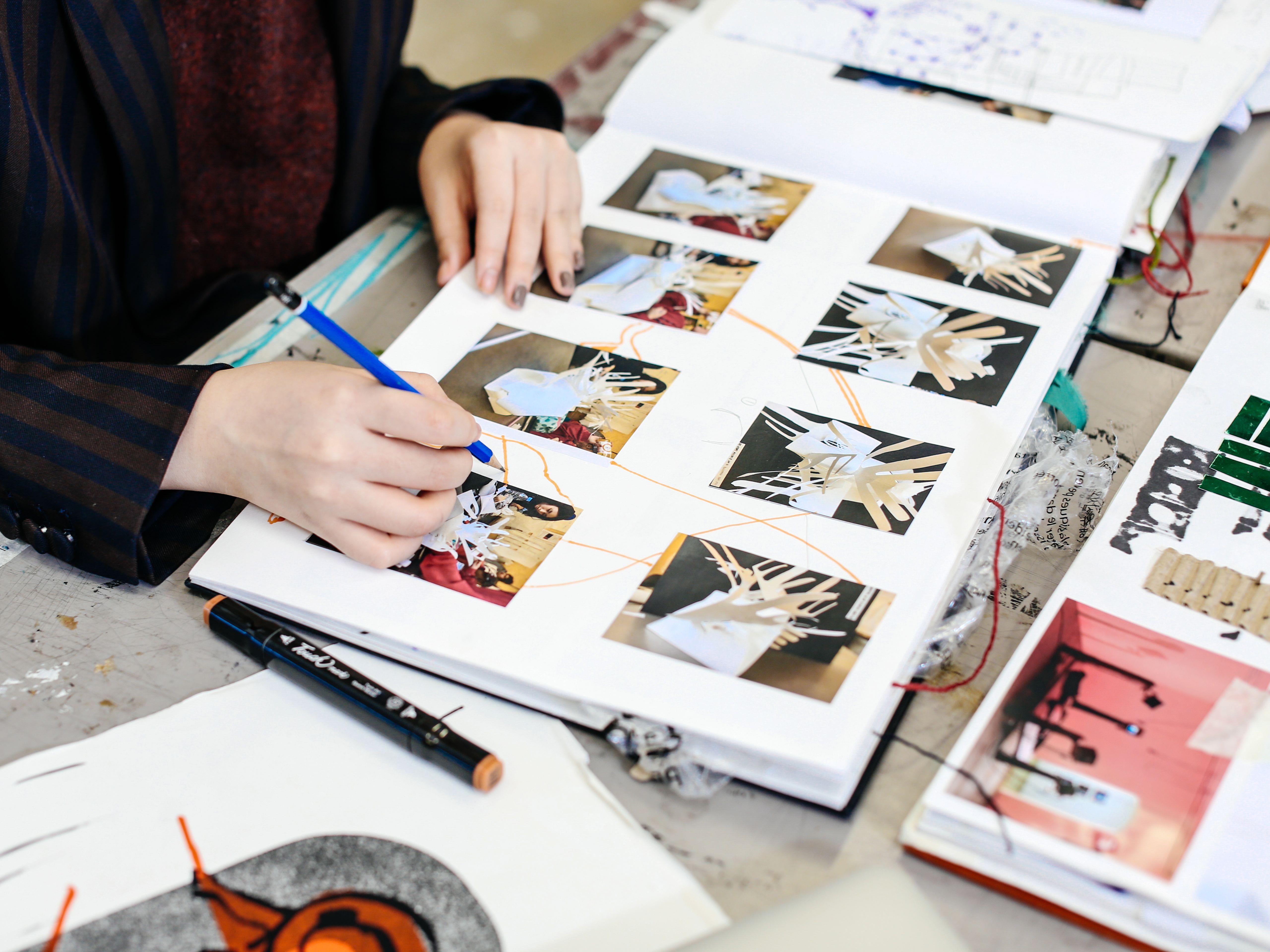 Student working in sketchbook