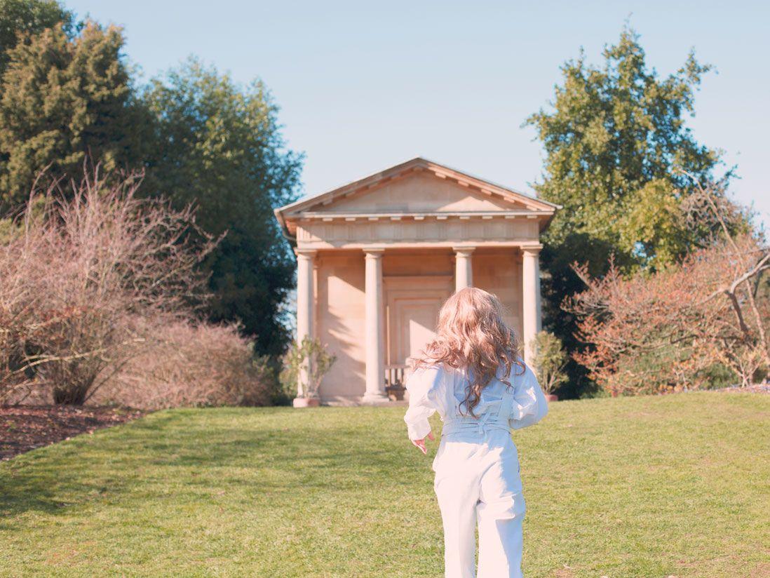 woman running in garden