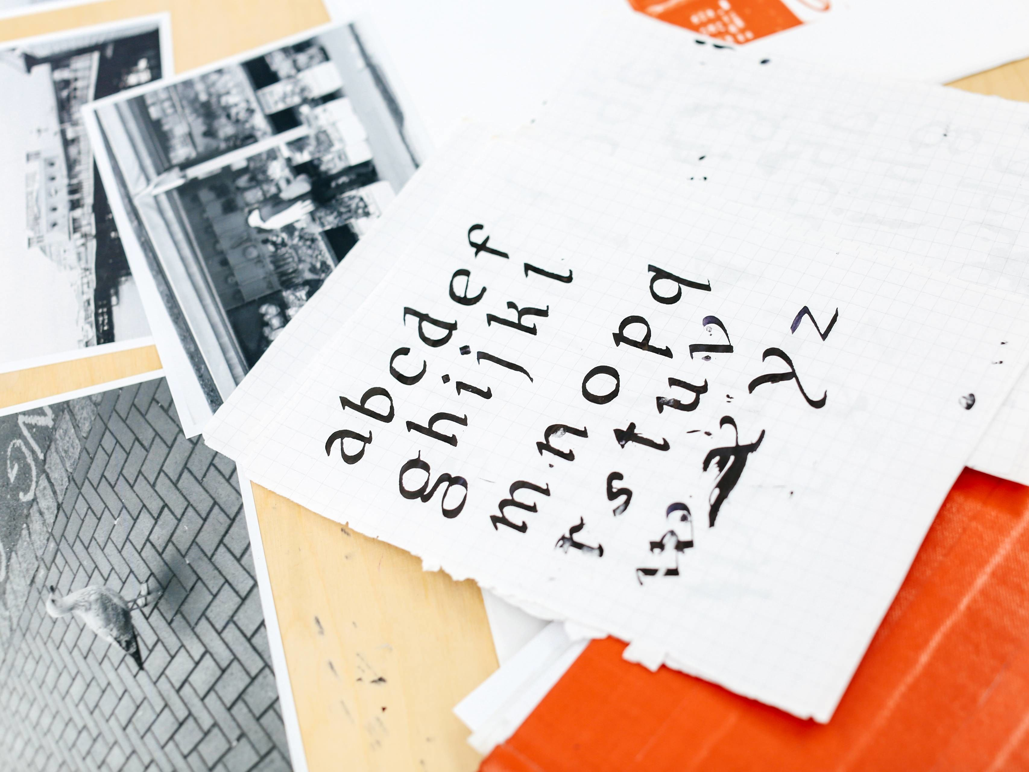 Set of prints with letters and photographs.