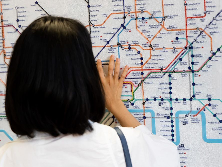 Woman reading London underground map