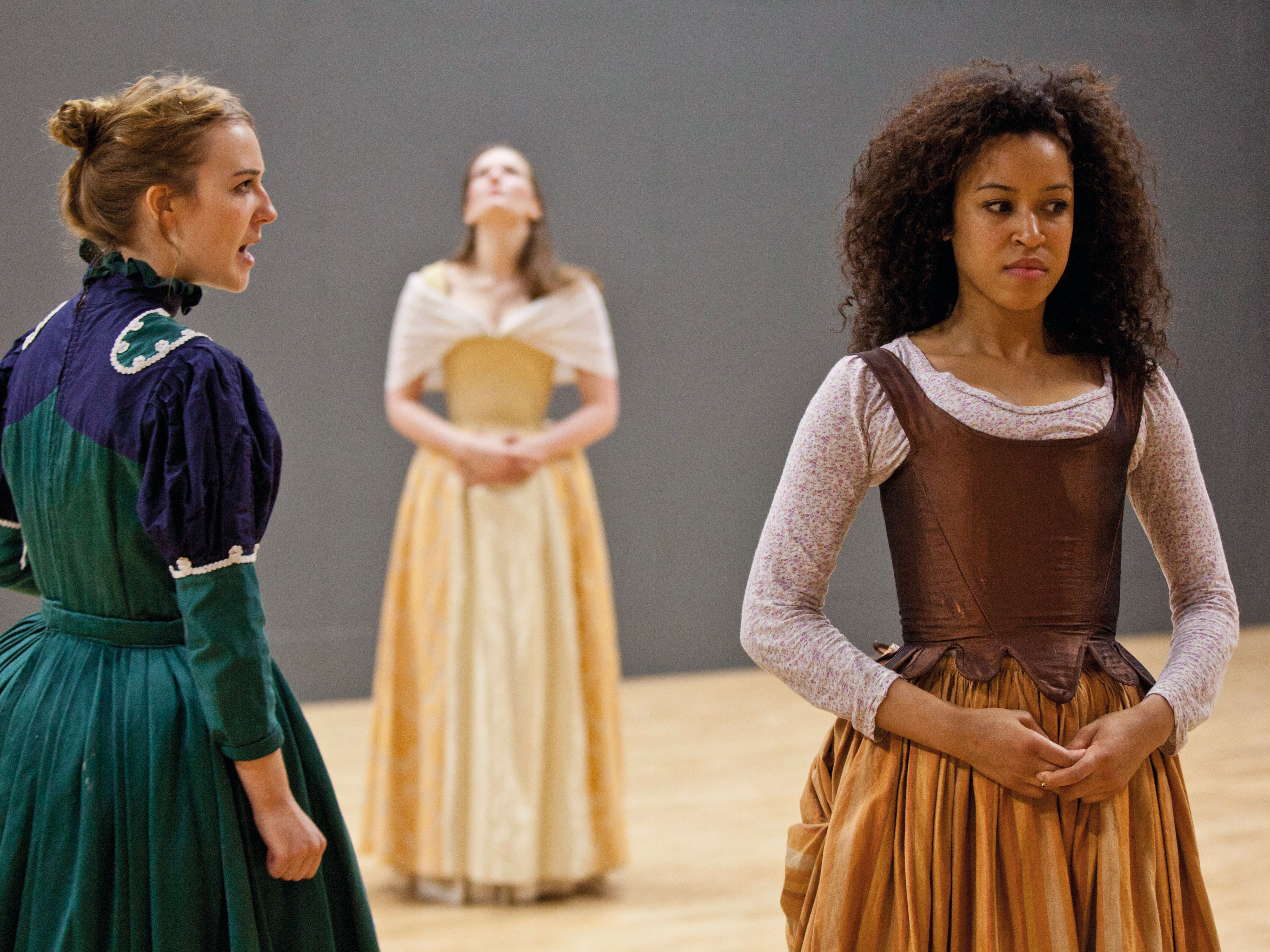 Acting students rehearsing in costume.