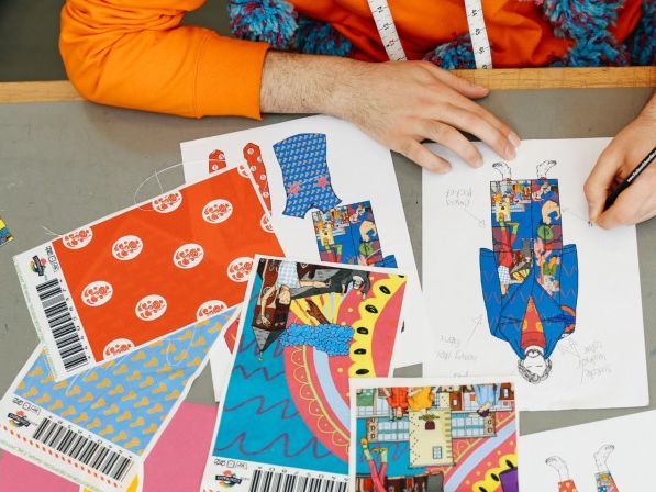 Student working on colourful fashion designs