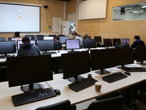 A room with people working at computers