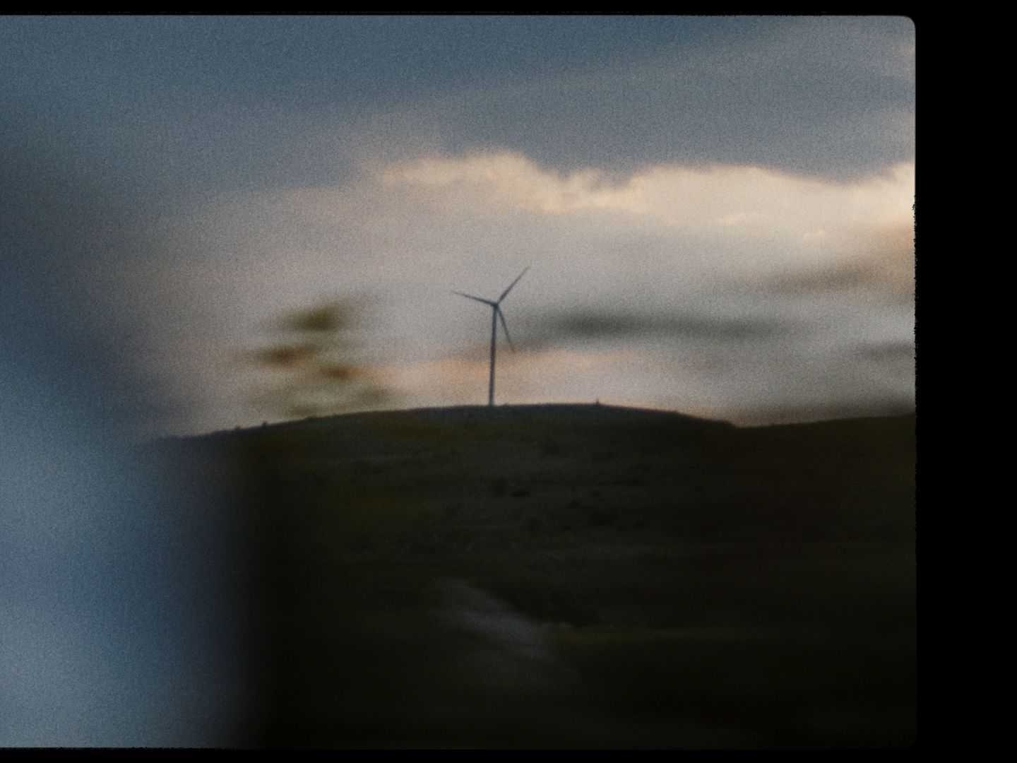 A landscape featuring a windmill.