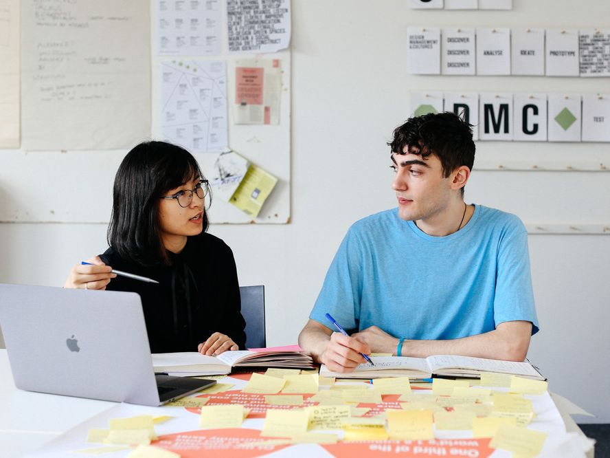 MA Design Management and Cultures, Ngoc (Sam) Trieu (left) and Calvin England (right) working in the Studio. Copyright holder: Alys Tomlinson
