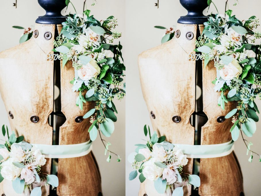 Mannequin bodice draped with flowers.