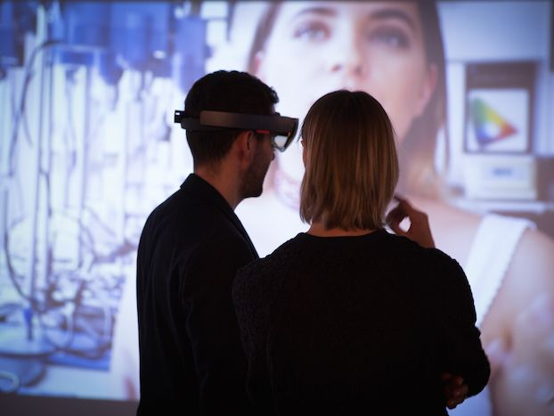 Two people in VR headsets.