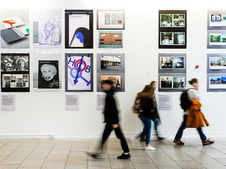 People walking at Imprint Exhibition
