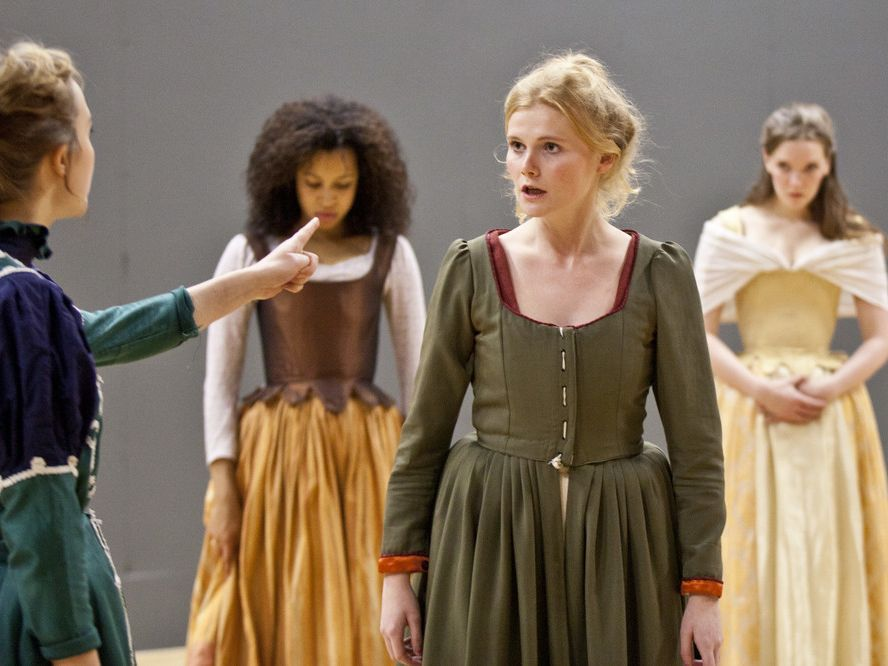 A group of actresses in period dress rehearsing a scene at Drama Centre London