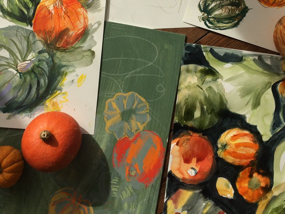 Laura McKendry illustrations of pumpkins and squashes, with real pumpkins and squashes sat on top of the illustrations.