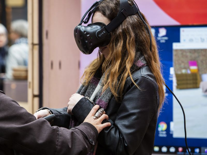 People using VR headsets at Fashion Means Business 19 by Fashion Innovation Agency at Spitalfields Market. Photography, Katy Davies.