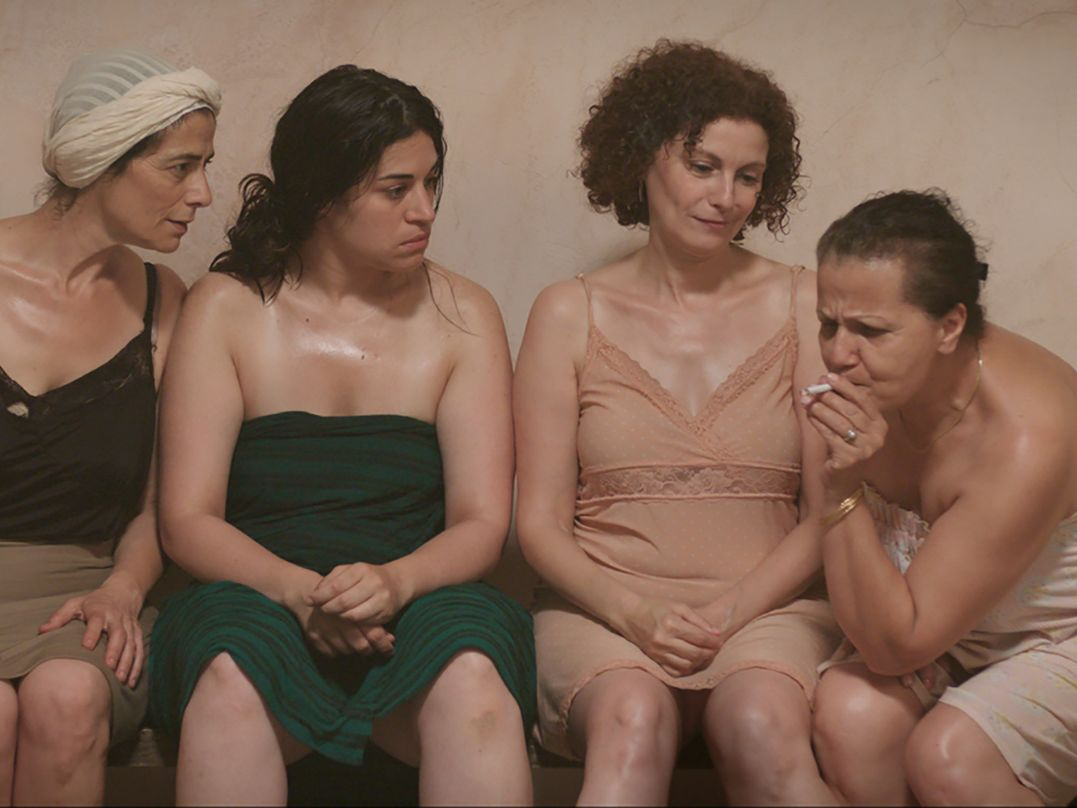 A film still of women in a public bath.