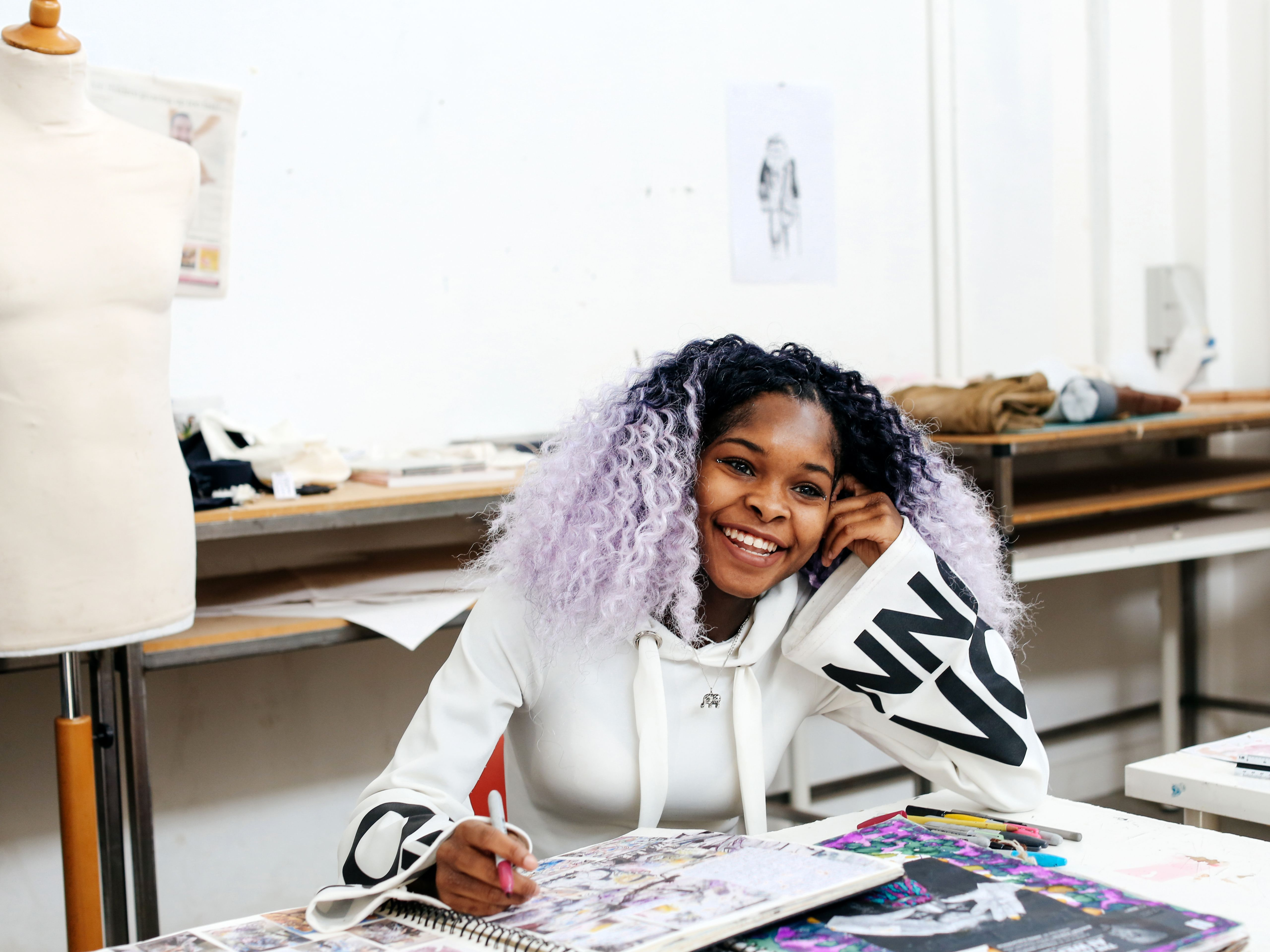 Student working on sketches in studio