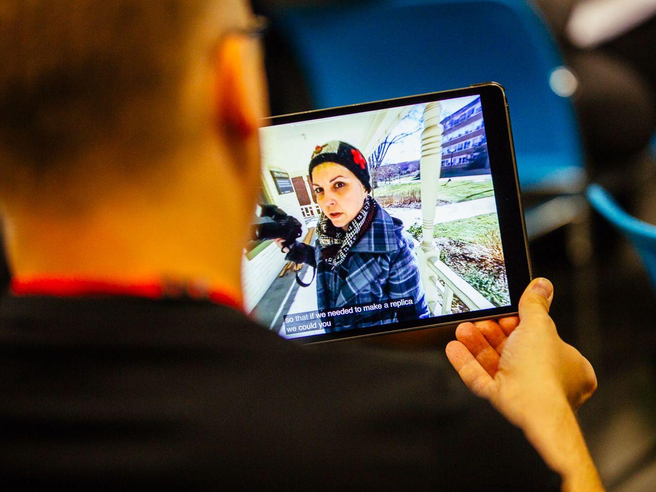 Woman holding videocamera
