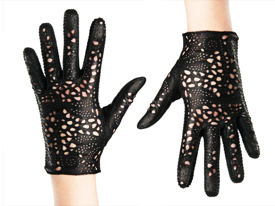 Black leather glove being worn, made by Riina Õun - repeat pattern,