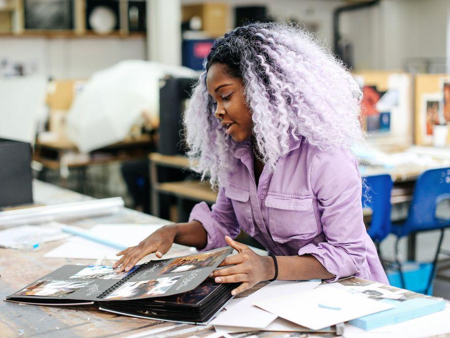 Tanikha (Renzo) Allen (BA Theatre Design, Wimbledon College of Art) showing her portfolio