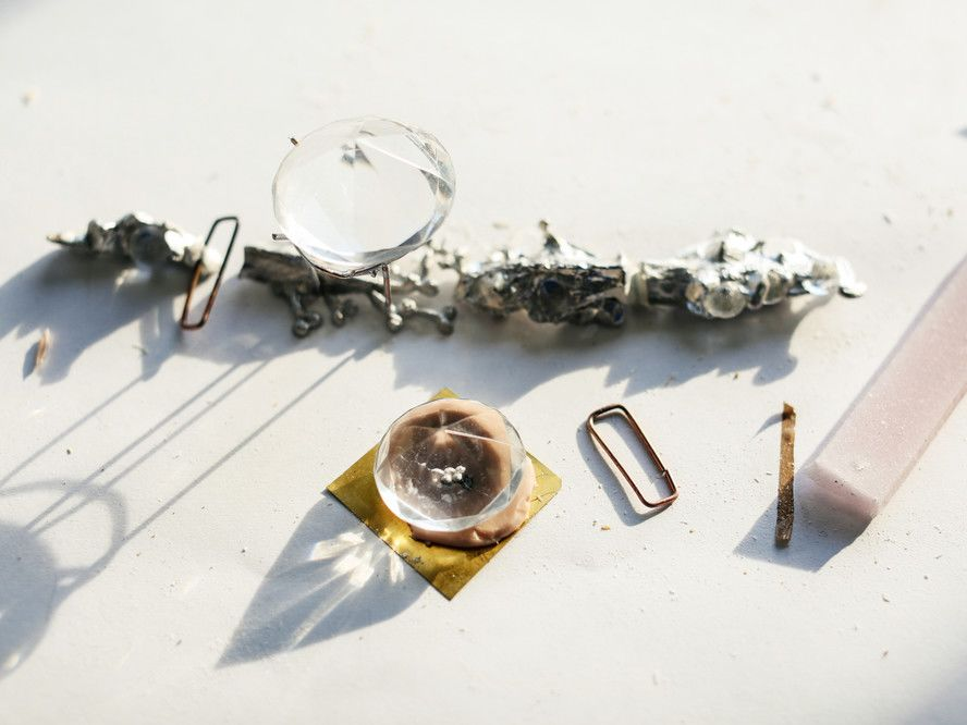 Two crystals and abstract metal items