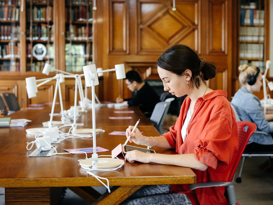 Woman studying in the Library, Copyright holder: Alys Tomlinson
