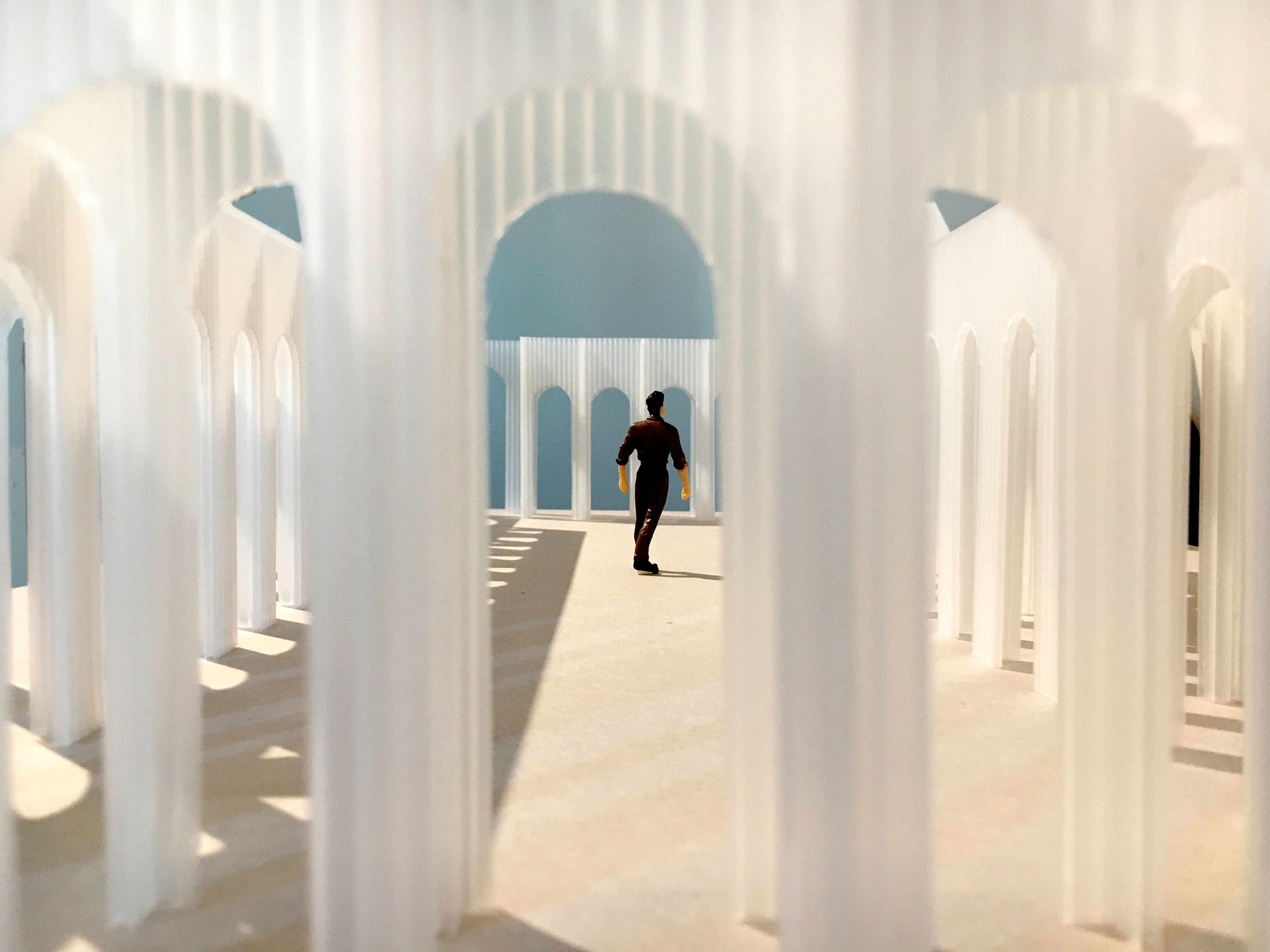Conceptual image depicting man within translucent arches