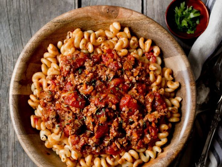 Birdseye photograph of a bowl of pasta and sauce