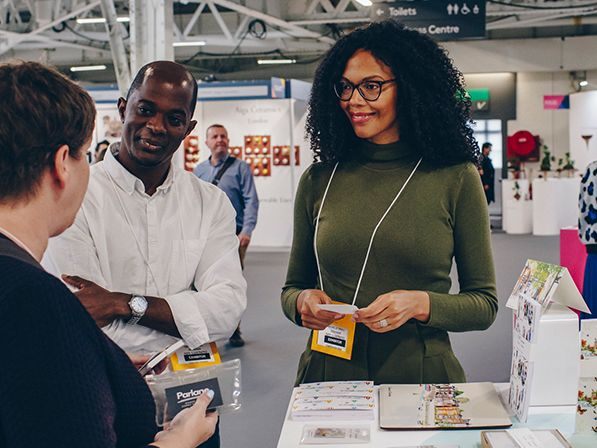 Photo of designer Michelle Njeri Small talking to buyers