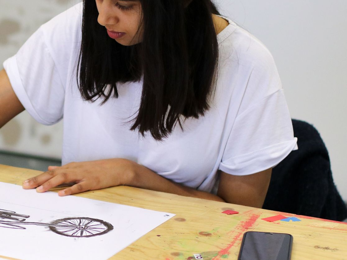 Student drawing a motorbike