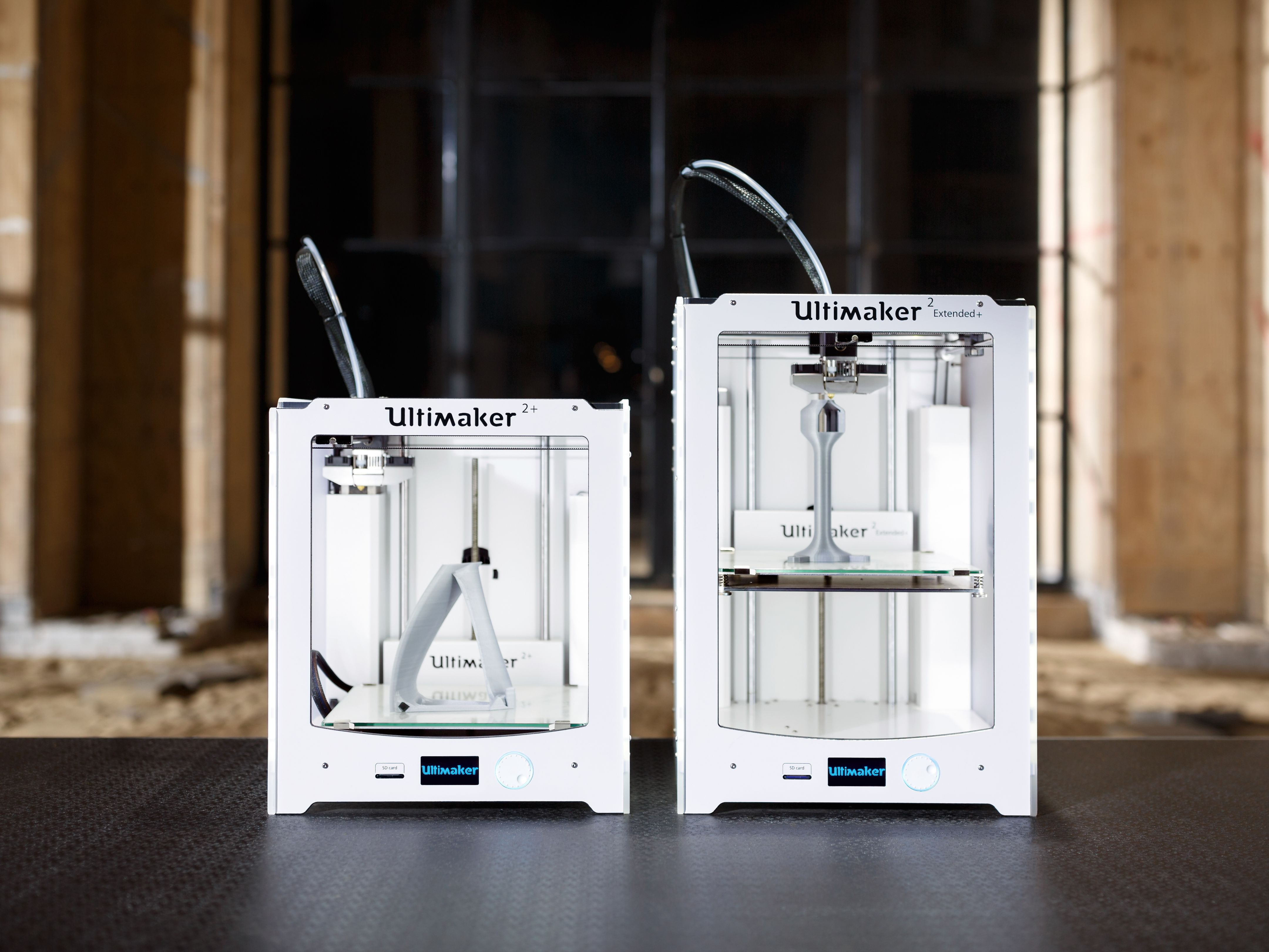Photo of 2 Ultimaker 3D printers.