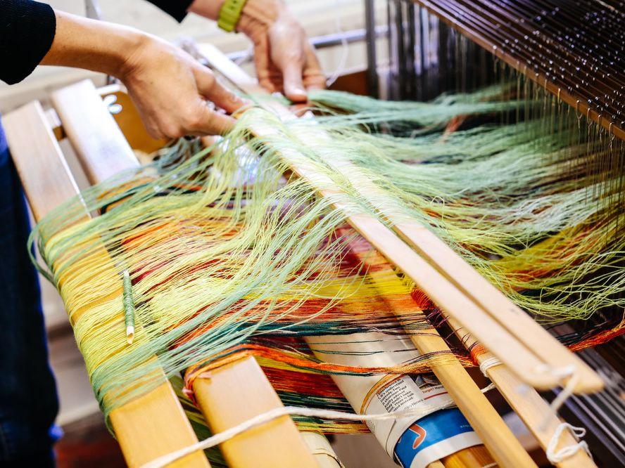 Technician using the weave machine.
