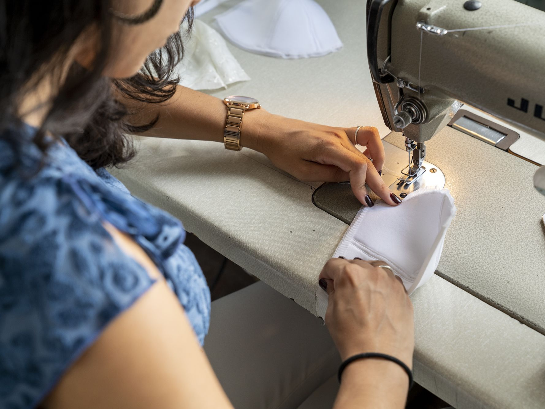 Structured bra making student working at sewing machine