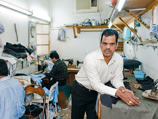 Tailors working in a sewing room