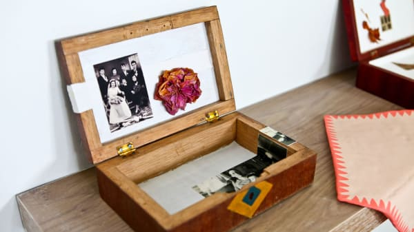 Wooden box with a photo inside sitting on a table