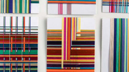 Photograph of different brightly coloured woven textile samples
